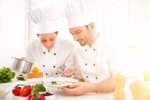 Two Chefs Working Preparing Food