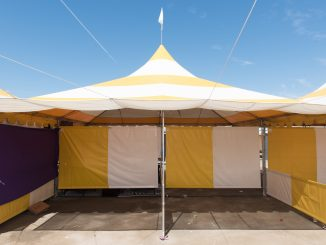 A canopy tent set up outside on a sunny day