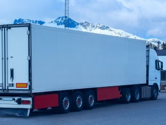White refrigerated truck on background of the mountains
