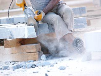 Industrial worker slicing marble