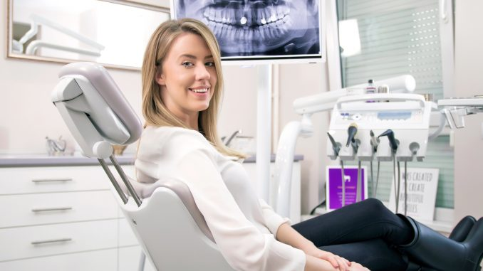 Woman seating on a dental chair