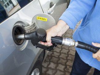 Car Filling Up on Fuel