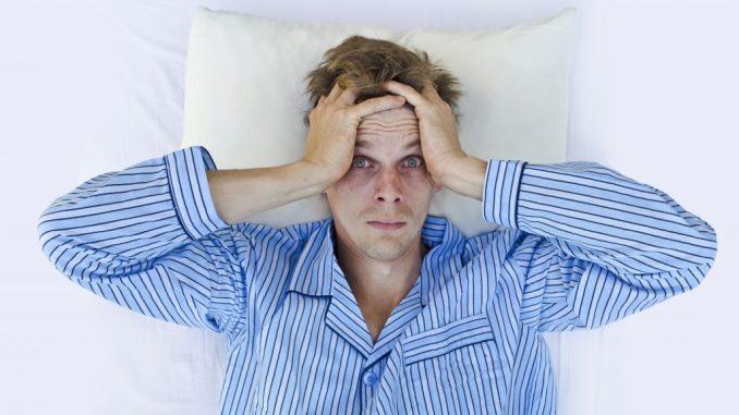 a frustrated man wearing blue pajamas