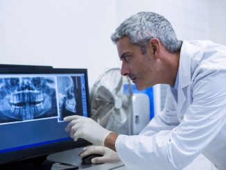 Dentist examining xray photo