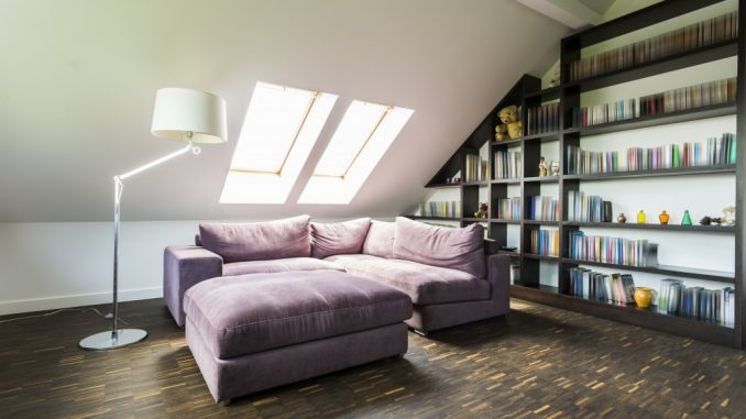 a purple sofa in the attic