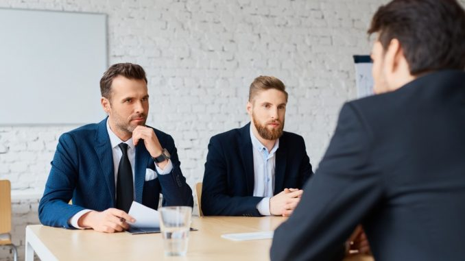 Two executives interviewing an applicant