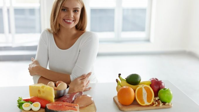Woman with different food products in front