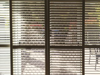 Plantation style elegant shutters window