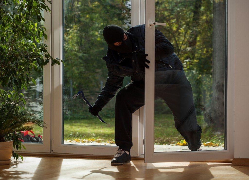 Burglar entering to house trough glass door