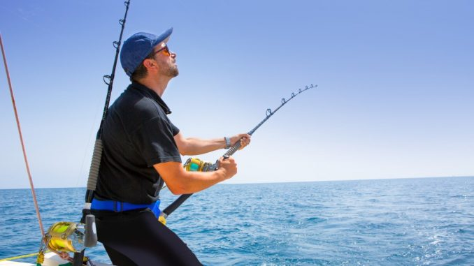Man fishing in the middle of the ocean