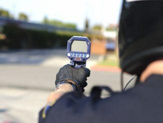 police holdig a radar gun