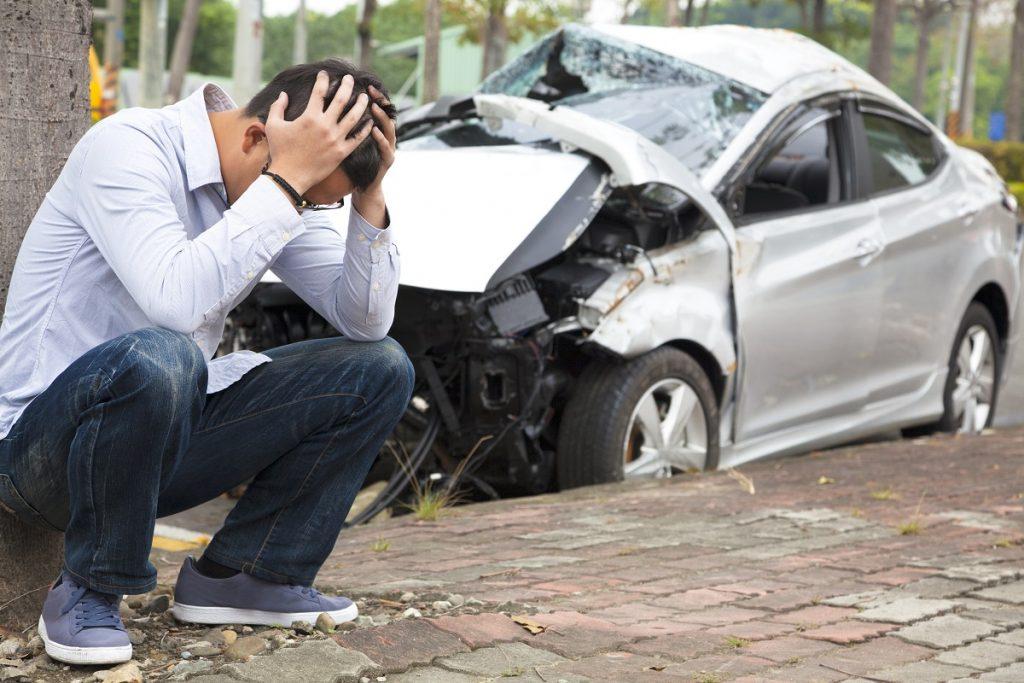 man suffering from headache after crash