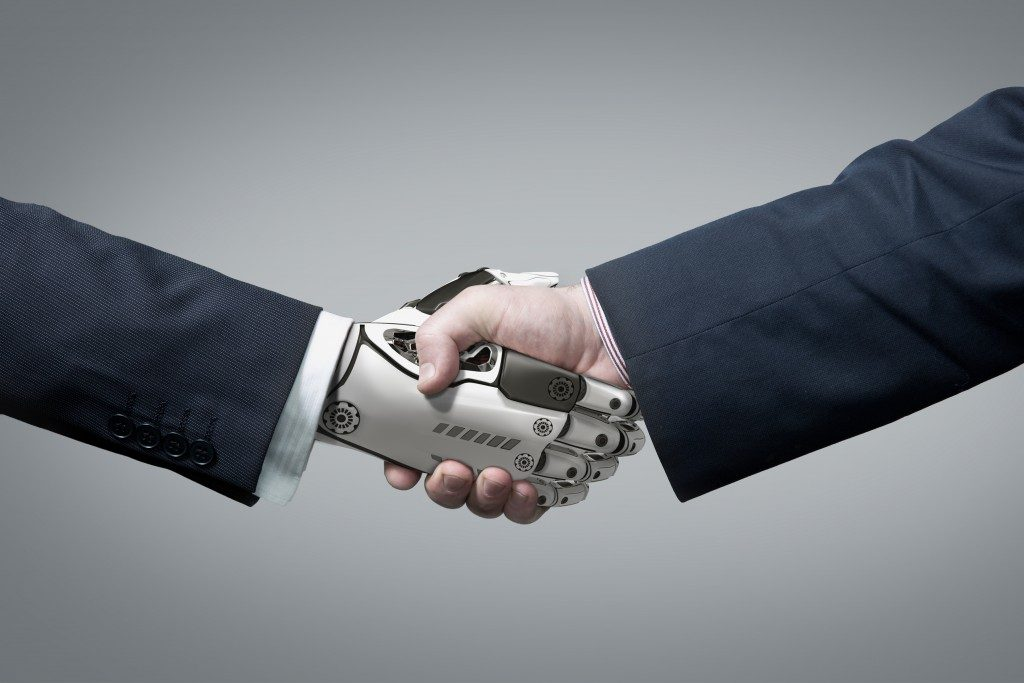 human shaking robotic hand