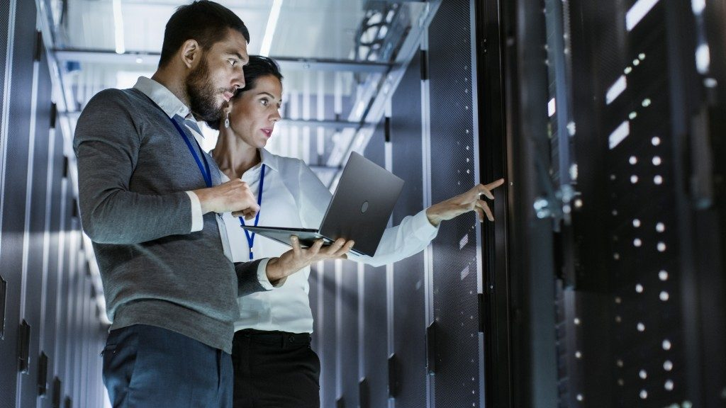 man and woman in a server room