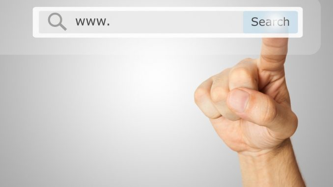 Hand pointing to the search button