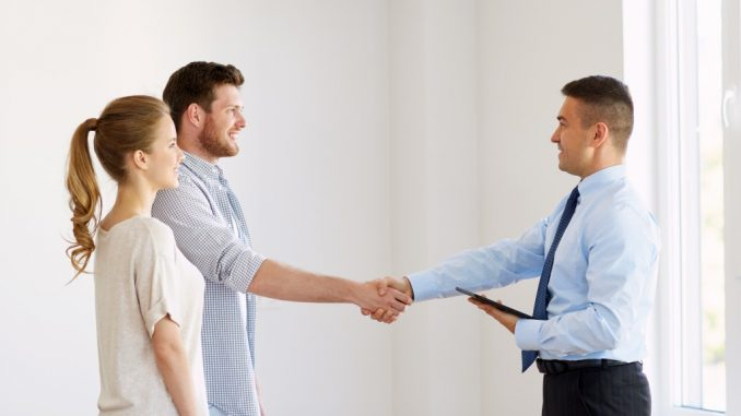 client and employee shaking hands