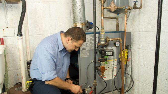 plumber fixing a gas pipe