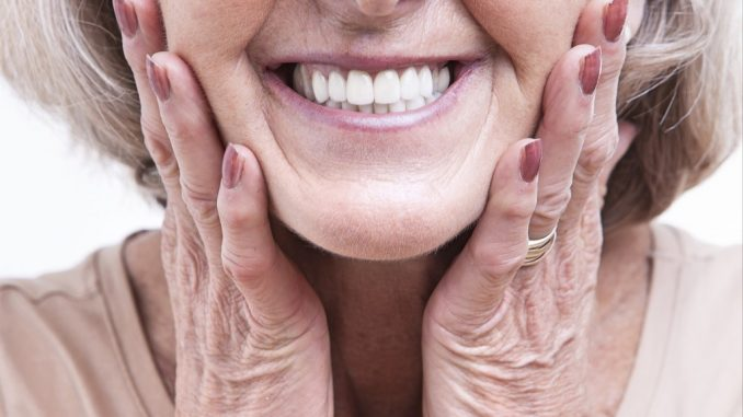old woman showing her white teeth