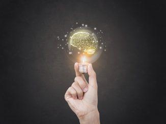 bright idea concept with brain inside a lightbulb