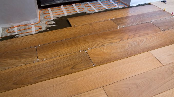 placing hardwood flooring