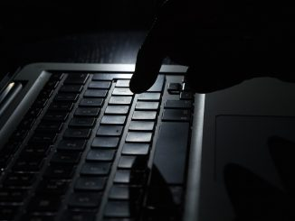 dark image of hacker's hand