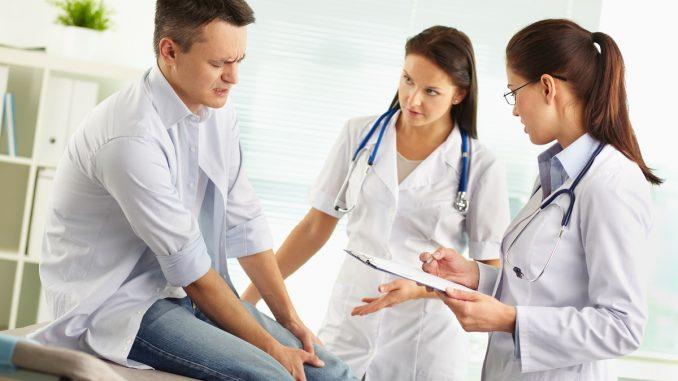 injured man in doctors
