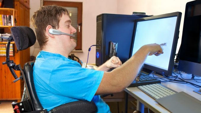 disabled man using the computer