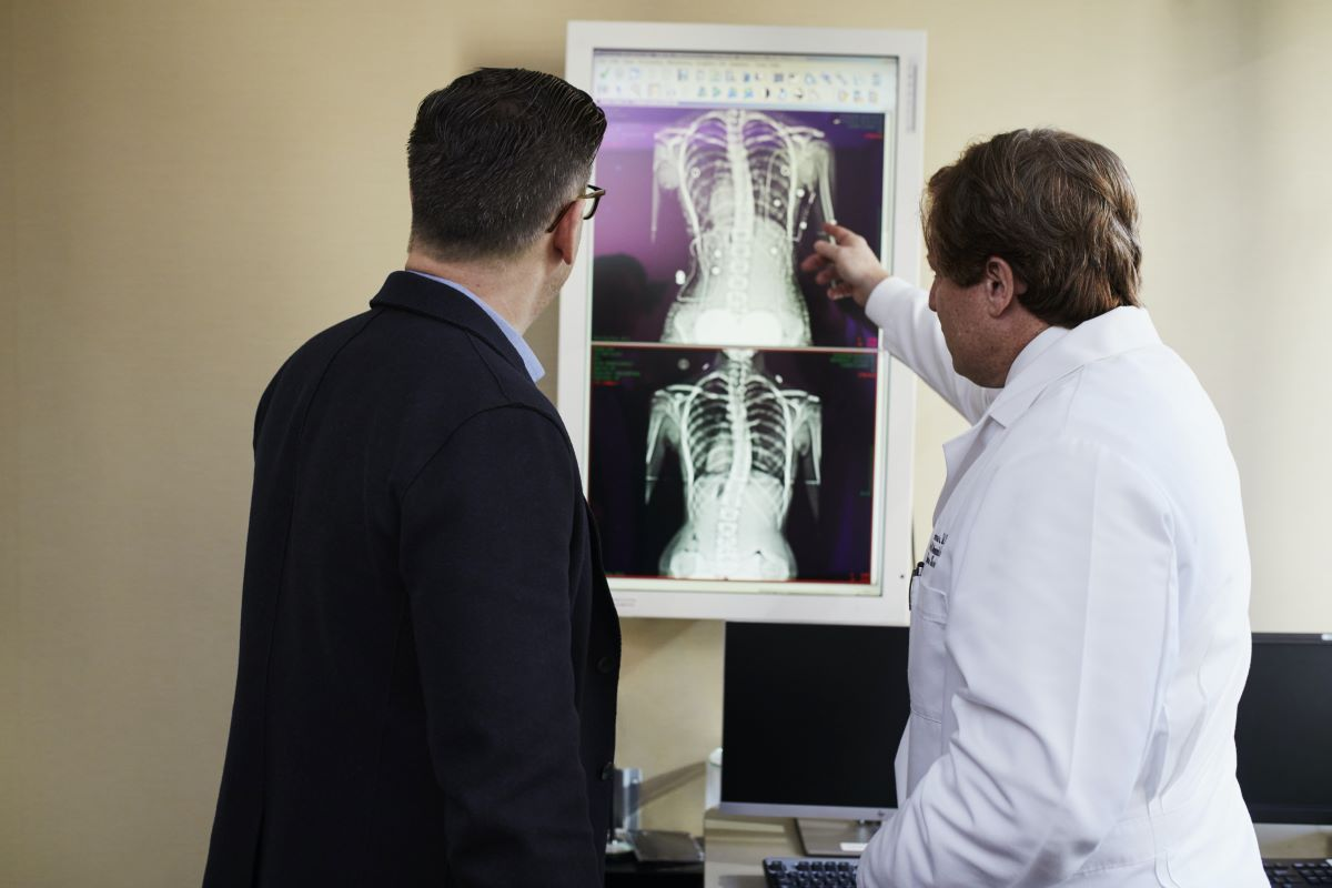 doctor pointing at x-ray