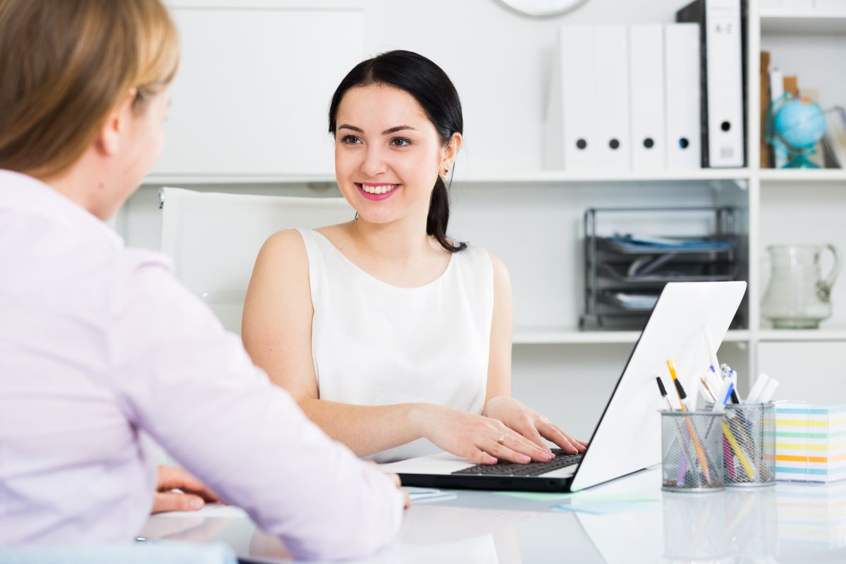 woman talking to another office mate