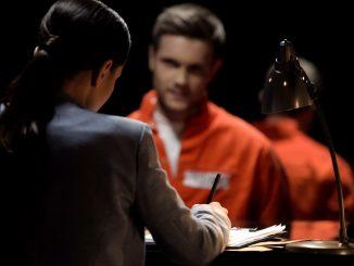 an offender getting interviewed