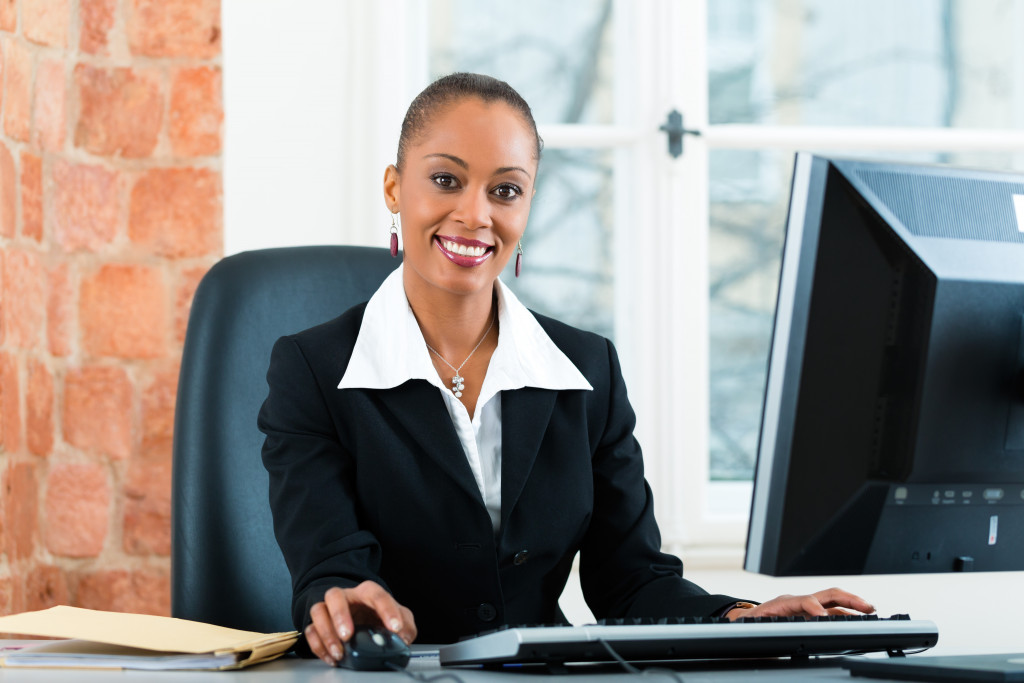 lawyer or paralegal working in her office